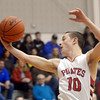 WARREN DILLAWAY / Star Beacon<br /> ANDY FOLEY of Perry pulls down a rebound on Friday night during a Division II sectional championship game at Perry.