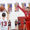 WARREN DILLAWAY / Star Beacon<br /> JAYDEN DIXON (2) of Harvey leaps in the air as Jacob Adams of Jefferson (13) looks to pass on Friday night during a Division II sectional championship game at Jefferson.