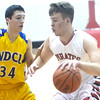 WARREN DILLAWAY / Star Beacon<br /> ZACK BUESCHER of Perry drives to the basket as Aidan Miachak of Notre Dame Cathedral Latin (34) defends on Friday night during a Division II sectional championship game at Perry.