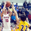 WARREN DILLAWAY / Star Beacon<br /> ANDY FOLEY of Perry prepares to shoot as Aaron Hummer of Notre Dame Cathedral Latin (22) defends on Friday night during a Division II sectional championship game at Perry.