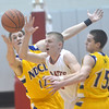 WARREN DILLAWAY / Star Beacon<br /> D.J. AULTMAN of Perry (center) reaches for the ball with Brendan Leininger (12) and Notre Dame Cathedral Latin teammate Ryan McMahon (15) on Friday night during a Division II sectional championship game at Perry.