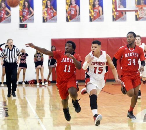 WARREN DILLAWAY / Star Beacon<br /> BREVIN WHITE (15) of Jefferson has the ball swatted away by Derrayle Robinson (11) of  Harvey as Red Raider teammate Isaiah Haynes (34) follows on Friday night during a Division II sectional championship game at Jefferson.