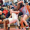 WARREN DILLAWAY / Star Beacon<br /> KEITH GRIFFIN (left) of Lakeside wrestles Justin DeMicco for the Division I district title at 138 pounds on Saturday night at Mentor High School.