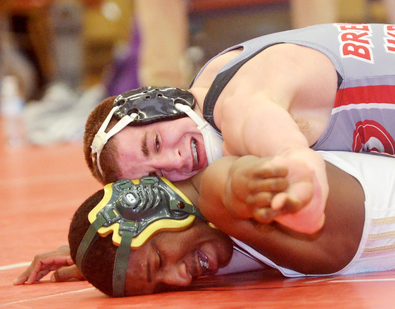 WARREN DILLAWAY / Star Beacon<br /> KEITH GRIFFIN (bottom of Lakeside) wrestles Justin DeMicco for the Division I district title at 138 pounds on Saturday night at Mentor High School.