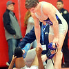 WARREN DILLAWAY / Star Beacon<br /> JARRAD LASKO (standing) of Madison shakes hands with Juwan Moss of Maple Heights after pinning him to earn 5th place in the 138 pound class of the  Division I district title  on Saturday night at Mentor High School.