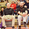 WARREN DILLAWAY / Star Beacon<br /> KEVIN WELSH, Lakeside wrestling coach, (right) and his assistant Kevin Rinehart watch Keith Griffin's 138 pound bout Division I district championship bout on Saturday night at Mentor High School.