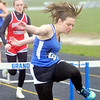 WARREN DILLAWAY / Star Beacon<br /> CRYSTAL BYLER of Grand Valley leads a heat of the 100 meter hurdles with Mackenzie Herman of Edgewood close behind on Thursday during a dual meet in Orwell.