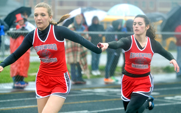 WARREN DILLAWAY / Star Beacon<br /> SHELLEY SPORCICH (left) receives the baton from Sarah Stell during the 4 x 200 meter relay on Thursday afternoon at Grand Valley.
