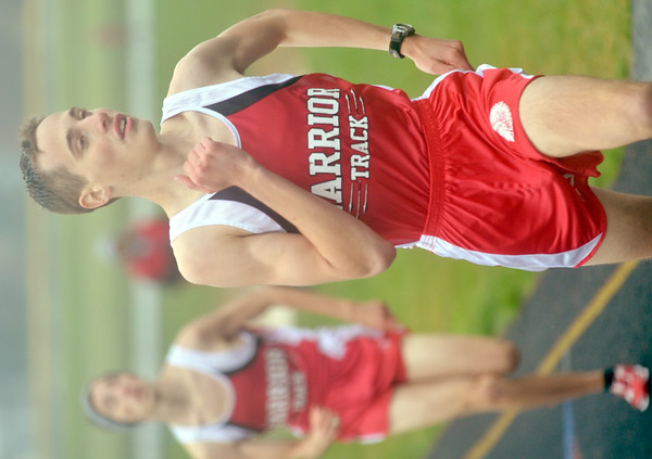 WARREN DILLAWAY / Star Beacon<br /> CHRIS LEMAY, (right) and his twin brother Josh,  of Edgewood, run the 1600 meter run on Thursday afternoon during a dual meet at Grand Valley.