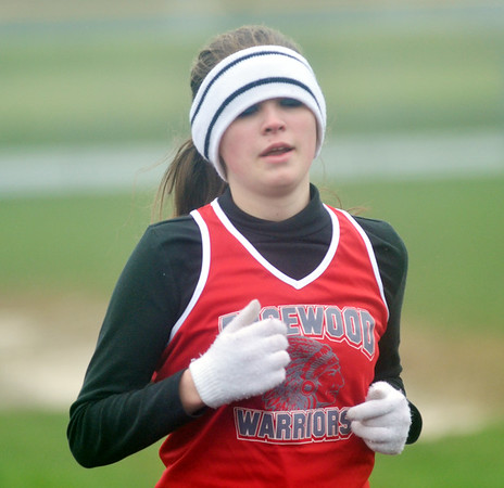 WARREN DILLAWAY / Star Beacon<br /> TIFFANY WELTON of Edgewood tries to stay warm on Thursday afternoon during the 1600 meter run at Grand Valley.