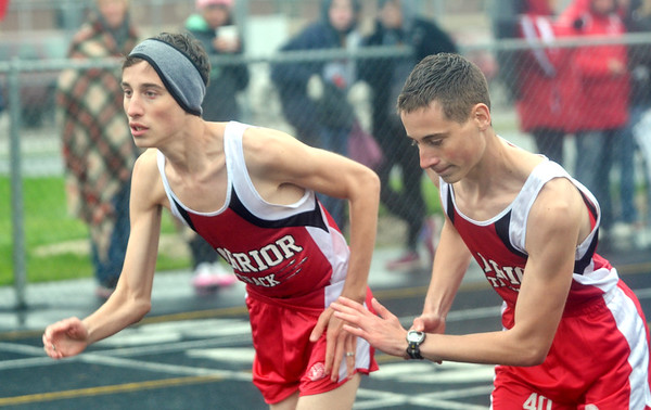 WARREN DILLAWAY / Star Beacon<br /> CHRIS LEMAY, (right) and his twin brother Josh,  of Edgewood, break from the starting line during the 1600 meter run on Thursday afternoon during a dual meet at Grand Valley.