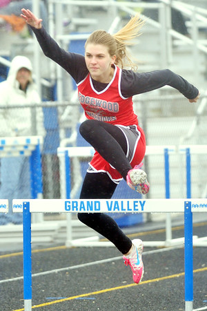 WARREN DILLAWAY / Star Beacon<br /> LEAH JOSLIN of Edgewood runs the 100 meter hurdles on Thursday afternoon during a dual meet at Grand Valley.