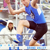 WARREN DILLAWAY / Star Beacon<br /> MICHAEL MCGOVERN of Grand Valley runs the 110 meter hurdles on Thursday afternoon during a home dual meet with Edgewood.