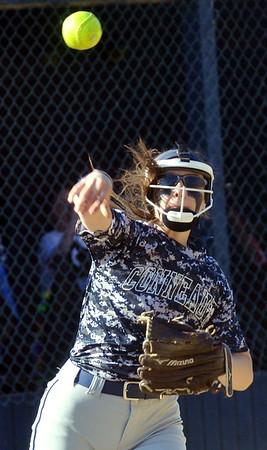 WARREN DILLAWAY / Star Beacon<br /> TAYA HIGLEY of Conneaut fires to first base on Friday afternoon during a home game with Kirtland at Skippon  Park in Conneaut.