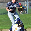 WARREN DILLAWAY / Star Beacon<br /> CAM GARCIA of Kirtland slides safely into second base as Emily Lower of Conneaut grabs a late throw on Friday during a home game with Kirtland at Skippon Park in Conneaut.