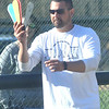 WARREN DILLAWAY / Star Beacon<br /> CONNEAUT SOFTBALL coach Nick Armeni signals to a batter on Friday during a home game with Kirtland.