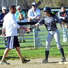 WARREN DILLAWAY / Star Beacon<br /> ALYSSA CHADWICK of Conneaut receives congratulations from softball coach Nick Armeni on Friday afternoon at Skippon Park in Conneaut.