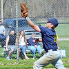 WARREN DILLAWAY  / Star Beacon<br /> KEVIN HENDERSON of the Conneaut Major Blue team makes the last putout of the game on Saturday at Skippon Park in Conneaut.