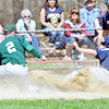 WARREN DILLAWAY / Star Beacon<br /> ISAIAH NGIRAINGAS (6) of Conneaut slides safely home as Josh O'Block of Lakesidee grabs the late throw under the watchful eye of umpire Steve Perry on Saturday afternoon during a game at Conneaut's Skippon Park.