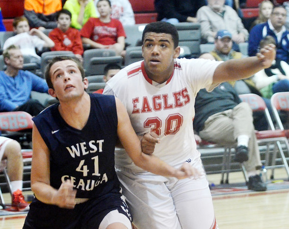 WARREN DILLAWAY / Star Beacon<br /> TRAVON MILLER (30) of Geneva battles for position with Chris Zannetti of West Geauga on Friday night in Geneva.