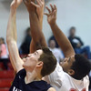 WARREN DILLAWAY / Star Beacon<br /> BEN HESTER (10) of West Geauga battles for a rebound with Travon Miller (30) of Geneva on Friday night in Geneva.