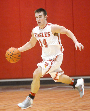 WARREN DILLAWAY / Star Beacon<br /> ZAC SWEAT of Geneva dribbles up court on Friday night during a home game with West Geauga.