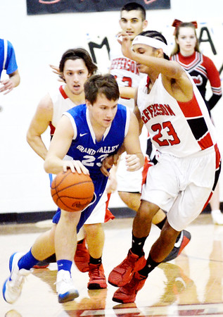 WARREN DILLAWAY   Star Beacon<br /> Jefferson defenders Joe Jackson (23), Sage Cantini (left back) and Jacob Adams (back centr) keep a close eye on Grand Valley's Tyler Butler on Tuesday evening at Jefferson.