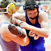WARREN DILLAWAY / Star Beacon<br /> Grand Valley's Cody Rhoades (right) tries to escape from Dayton Christian's Henry Danishek on Friday during a Division III 138 pound consolation match at the Ohio High School Athletic Association State Wrestling Tournament at the Schottenstein Center in Columbus.