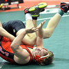 WARREN DILLAWAY / Star Beacon<br /> Perry's Evan Schenk (face showing) tries to escape during a Division II 182 pound consolation match on Friday during the Ohio High School State Wrestling Tournament in Columbus.