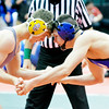 WARREN DILLAWAY / Star Beacon<br /> Grand Valley's Cody Rhoades (right) wrestles Dayton Christian's Henry Danishek during a 138 pound consolation match on Friday during the Ohio State High School Wrestling Tournament at the Schotten Stein Center in Columbus.