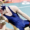 WARREN DILLAWAY / Star Beacon<br /> Conneaut's Justin Mason (top) wrestles Winersville Indian Creek's Miles Mazik on Friday during a Division II 138 pound consolation match at the Ohio High School Athletic Association State Wrestling Tournament at the Schottenstein Center in Columbus.