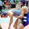 WARREN DILLAWAY / Star Beacon<br /> Grand Valley's Cody Rhoades (right) controls Dayton Christian's Henry Danishek during a 138 pound consolation bout on Friday at the Ohio High School State Wrestling Tournament in Columbus.