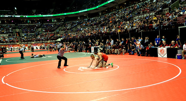 WARREN DILLAWAY / Star Beacon<br /> Pymatuning Valley's Gaige Willis tries to escape the grasp of Oak Harbor's  Kian Thompson on Friday morning during a Division III 182 pound quarterfinal at the Division III Ohio State High School State Wrestling Tournament at the Schottenstein Center in Columbus.