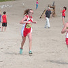WARREN DILLAWAY / Star Beacon<br /> EMILY DEERING (far right) of Geneva leads Edgewood's Savannah Spring (center) and  Lakeside's Kristen Berus Monday at the War on the Shore at Lake Shore Park in Ashtabula Township.