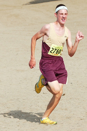 WARREN DILLAWAY / Star Beacon<br /> CORY MIENTKIEWICZ of Pymatuning Valley sprints down the beach at Lake Shore Park during the War on the Shore Monday.