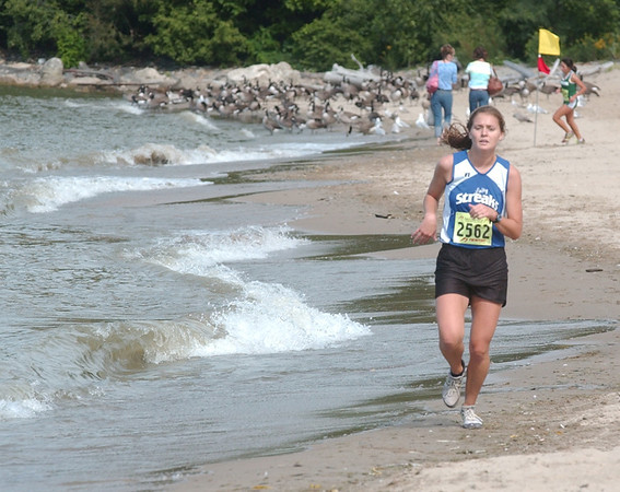 WARREN DILLAWAY / Star Beacon<br /> ERIN HORD won the War on the Shore Monday for the Madison Blue Streaks in a time of 21:39 at Lake Shore Park in Ashtabula Township..