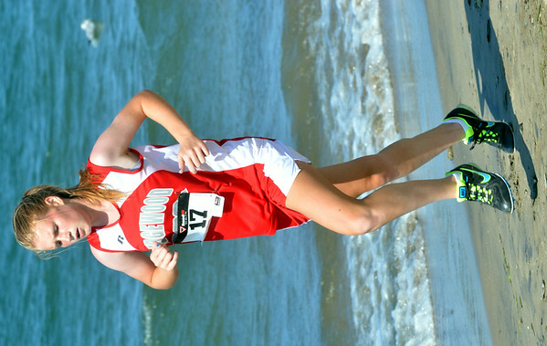 WARREN DILLAWAY / Star Beacon<br /> ANDREA ZUCCAARO of Edgewood runs the War on the Shore Cross Country Invitational at Lake Shore Park in Ashtabula on Monday afternoon.
