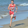 WARREN DILLAWAY / Star Beacon<br /> JOSH LEMAY (148) of Edgewood leads a group of runners during the War on the Shore Cross Country Invitational at Lake Shore Park in Ashtabula on Monday afternoon.