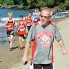 WARREN DILLAWAY / Star Beacon<br /> CHRIS SIMMONS, Edgewood assistant cross country coach, yells to his team on Monday afternoon during the War on the Shore Cross Country Invitational at Lake Shore Park in Ashtabula Township.