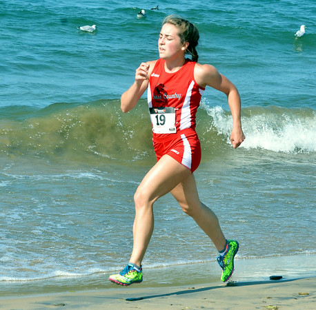 WARREN DILLAWAY / Star Beacon<br /> EMILY DEERING of Geneva won the War on the Shore Cross Country Invitational at Lake Shore Park in Ashtabula on Monday afternoon.