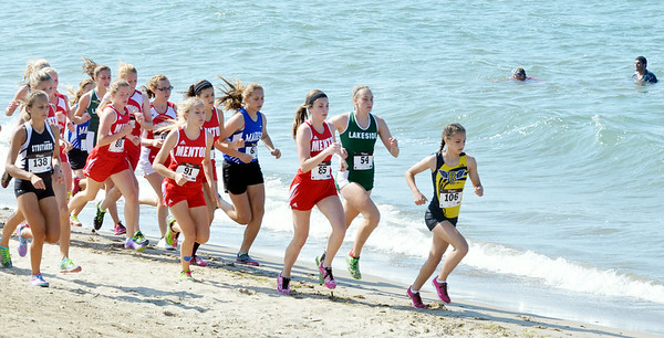 WARREN DILLAWAY / Star Beacon<br /> RUNNERS START the War on the Shore Cross Country Invitational at Lake Shore Park in Ashtabula Township on Monday afternoon as swimmers enjoy a dip in Lake Erie.