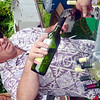 WARREN DILLAWAY / Star Beacon<br /> BENNY MUCCI of Bene Veno in Perry pours a glass of wine during the Wine and Walleye Festival  in Ashtabula on Saturday.
