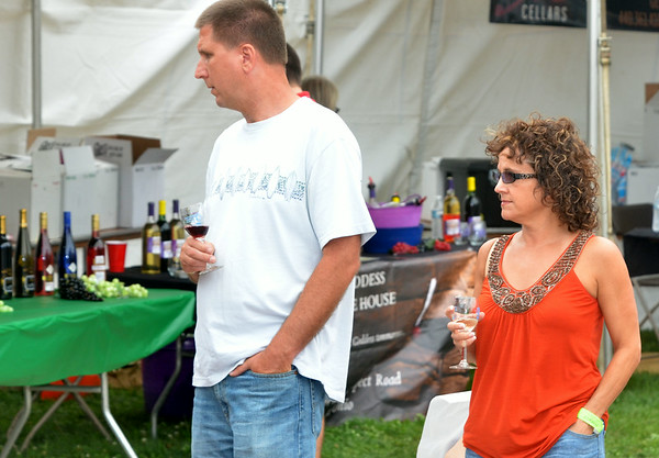 WARREN DILLAWAY / Star Beacon<br /> DAN AND Pam Mihalik of Youngstown take a trip through the wine area on Saturday at the Wine and Walleye Festival in Ashtabula.