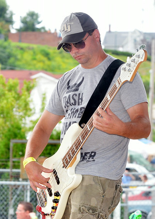WARREN DILLAWAY / Star Beacon<br /> ROB LUNDI of Dashboard Jesus prepares a performance on Saturday during the Wine and Walleye Festival in Ashtabula.