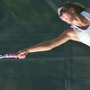 WARREN DILLAWAY / Star Beacon<br /> SYDNEY VANHOY of Geneva serves on Monday during a second singles match with Mentor.