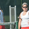 WARREN DILLAWAY / Star Beacon<br /> EMILY FORMAN (left) and Geneva first doubles partner Laken Anderson prepare for the next point during a home match with Mentor.
