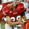 WARREN DILLAWAY / Star Beacon<br /> ALEX FISTEK, Geneva quarterback, prepares to hand off on Friday night at Spire Institute.