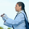 WARREN DILLAWAY / Star Beacon<br /> MICHAELA RODGERS, Conneaut High School band drum major, directs the alma mater on Friday evening during opening night action in Conneaut.