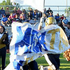 WARREN DILLAWAY / Star Beacon<br /> BRIAN DURIS (right hidden) carries the Conneaut flag on Friday night as he breaks the banner with teammate Dallis Burdick to kick off the 2014 football season at Conneaut Stadium..