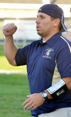 WARREN DILLAWAY / Star Beacon<br /> CONNEAUT FOOTBALL Coach Rocco Dobran calls a play on Friday night during a home game with Grand Valley.